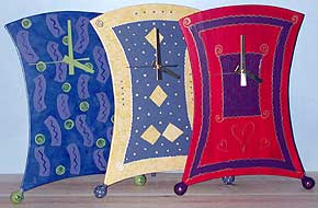 So whimsical they look like they'll walk right off the table! Great engagement or graduation gifts. These clocks will perk up any bedroom, office or den.
