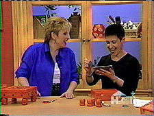 Sharing a laugh with Sue Warden on HGTV, artist Debra Gould demonstrates how she creates her one of a kind treasure boxes.