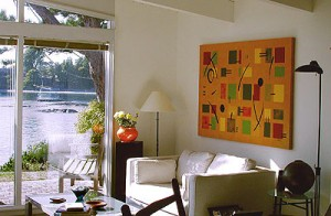"""This series of abstract paintings looks very strong in a modern setting. """"Your Move"""" is painted on a layered background of various shades of yellow, iridescent gold and bronze, and ochre. The design is in yellow, light and olive greens and red clay with black accents. Size 70"""" x 50"""". Stretched and mounted onto 1.5"""" deep stretcher bars - no need for framing. Price $1500. SOLD All paintings shown here are signed originals, acrylic on canvas."""